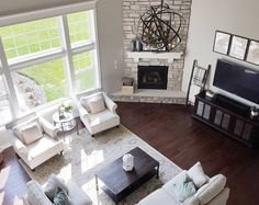 Similar floor plan and corner fireplace to our house, different furniture layout we could try