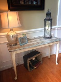 This sofa table was painted in several colors.  The top was done to look like old wood slats.  I taped off the stripes leaving a bit of the natural wood in between each one to give the appearance of slats.  I love this look.