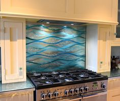 This beautiful glass splashback in Matlock, Derbyshire was made for a customer who had a mirror behind the cooker but was considering a splashback. They weren't sure about whether or not to remove the mirror and worked with Lisa to come up with a unique design that would fit over it instead of replacing it. The splashback turned out to be a very unique one and definitely a piece that we'll remember. Glass Wall Art, Fused Glass Art, Glass Kitchen, Kitchen Art, Custom Glass, Bespoke Kitchens, Splashback, Panel Art, Derbyshire