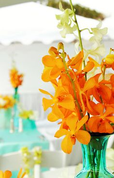 orange and teal coral and tiffany blue green reception wedding flowers,  wedding decor, wedding flower centerpiece, bouquet, wedding flower arrangement, add pic source on comment and we will update it. www.myfloweraffair.com can create this beautiful wedding flower look.