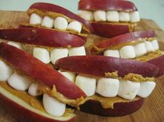 Apple slices & mini marshmallow smiles and for that extra hold try some peanut butter or Nutella!
