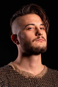 The best ideas for Viking hairstyles are gathered here. Find a short curly mens top knot, a medium undercut hairstyle, intricate Viking braids for long hair and many other stylish haircuts and beards for warriors in our gallery. #menshaircuts #menshairstyles #viking #vikinghaircut #vikinghairstyles #vikinghair Viking Haircut, Viking Hairstyles, Undercut Hairstyles, Tapered Undercut, Undercut Men, Medium Undercut, Stylish Haircuts, Haircuts For Men, Viking Braids