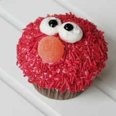 Elmo cupcake - I love that its not done with red frosting. What a mess colored frosting can be...