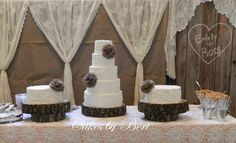 Rustic theme wedding cake - 6-810-12-14 with two 12 side cakes.  Displayed on real cross cut wood slabs.  Cakes are chocolate  white.  Cake table decorations designed by my daughter, friend of the bride.  Burlap flowers supplied by the bride.