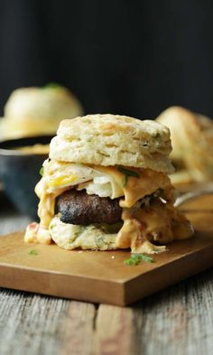 Egg, Sausage and Queso Breakfast Sandwich on Home Scallion Biscuit!
