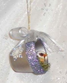 Silver bird in tiny plant pot