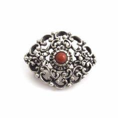 Een zilveren Jugendstil broche met koraal vind je bij Aurora Patina, de leukste sieraden webshop van Nederland!