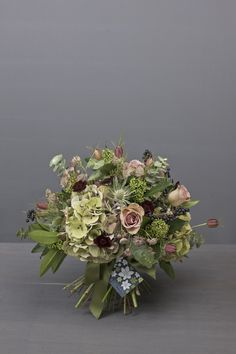 A gorgeous bunch of nostalgic country flowers including roses, astrantia, pussywillow, roses and various flowers changing through the seasons.
