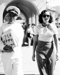Charlie Chaplin and Paulette Goddard taking a stroll on the boardwalk of Catalina Island, 1934