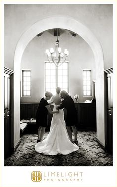 Wedding Venue   Bella Collina #wedding #photography #weddingphotography #BellaCollina #Montverde #Florida #stepintothelimelight #limelightphotography #bride #finalpreperations #laceherup #anticipation #archway #chandeler #windowlight