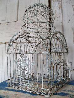 Reserved.  Ornate rusty painted wire birdcage large detailed distressed scroll style decor Anita Spero    It came in just a bronzy-brown with a