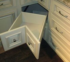 This is a way better way to utilize space than having the long dark cave of a cabinet. I want these in the corner.