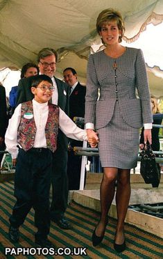 Diana, Princess of Wales, takes 10-year-old Laurence Chambers, from Coventry, for a walk, during her visit to Birmingham, where she opened the National Institute of Conductive Education.(1995)