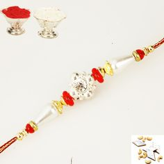 A beautiful traditional rakhi embedded with American diamond and pearl beads,and tikka  chawal pouches wishing goodl uck and happiness to your brother this Rakhi. http://www.ghasitaramgifts.com/product/r-5-rakhi-thread/