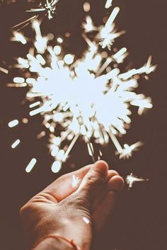 sparklers...keep your distance...recently read that sparklers are made of lead and let off extremely toxic fumes :/