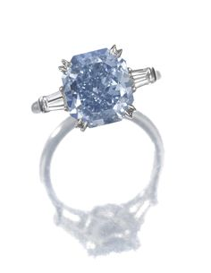 Important Fancy Vivid Blue diamond ring Claw-set with a fancy vivid blue cut-cornered rectangular modified brilliant-cut diamond weighing 4.16 carats, flanked by tapered baguette diamonds, mounted in platinum, size 51.