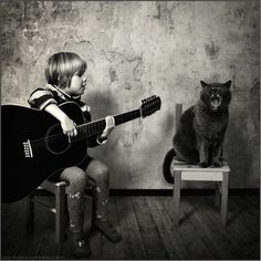 A girl and her cat Photo credit: Andy Prokh - http://ww - Imgur - Great, great series!