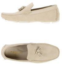 $228, Beige Suede Tassel Loafers: Bruno Magli Moccasins. Sold by yoox.com. Click for more info: https://lookastic.com/men/shop_items/274894/redirect