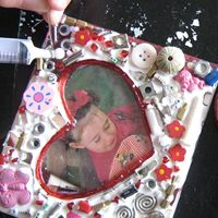 Recycle an old CD case into a mosaic picture frame