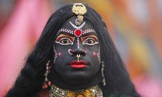 a man dressed as Hindu goddess Kali, participates in a religious procession in Allahabad, photo by  Rajesh Kumar Singh