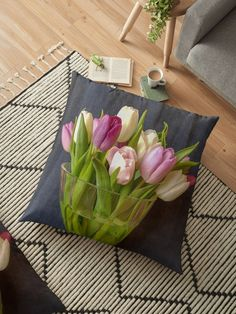 A vase of tulips in soft pink, mauve and purple set against the soft green stems and leaves. Tulips are better than one, when you have a bunch of flowers in a glass vase. Throw Pillows Bed, Bed Throws, Floor Pillows, Decorative Throw Pillows, Red And Yellow Roses, Floral Cushions, Bunch Of Flowers, Stems, Flower Vases