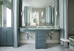 graceful, light on its feet double sink vanity. Traditional Bathroom by Mark WIlliams Design Associates