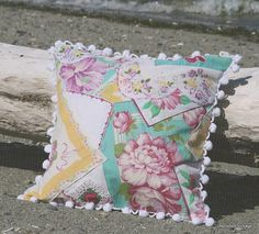 A pillow made from vintage hankies - I have some from my grandmother and great grandmother.