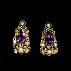 Earrings, ca. 1820s. French. Gold filigree, amethysts and pearls. V & A Museum.