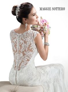 Gorgeous lace wedding dress, Melanie, by Maggie Sottero. We're swooning over that lace back! #wedding #bride