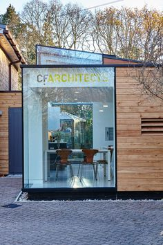 CF Architects builds its own timber and glass office on the side of a mid-century home.