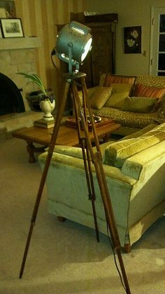 """Antique Movie/Theatre spotlight mounted on wooden antique tripod. Stands over 5 feet tall. Spotlight  is """"Little Giant"""" model 7200. For sale at Common Folk Co in Bellevue, WA 98008  (425) 747-4100  http://www.facebook.com/commonfolkco  $699"""