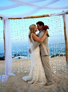 simple beach wedding altar with shell curtains wwwsandimentalmemoriescom sandimentalmemories