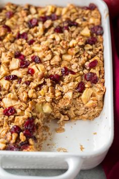 Baked oatmeal filled with apples, cinnamon, walnuts and cranberries. Perfect start to any morning! Hearty and perfectly satisfying.