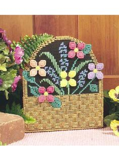 Flower Basket Doorstop- plastic embroidery with a brick or two.the designs are endless and great for holidays - plastic canvas Plastic Canvas Ornaments, Plastic Canvas Crafts, Plastic Canvas Patterns, Doorstop Pattern, Maya, Mesh Wreath Tutorial, Craft Free, Canvas Designs, Flower Patterns