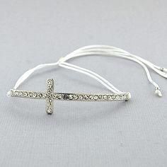 White Sideways Pave Crystal Cross Bracelet Pull String ❤ liked on Polyvore