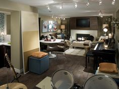 This neutral living room offers various venues for entertainment, from a space for creating music to a lounge-worthy media area.
