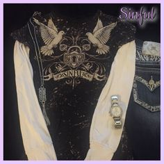 Sinful shirt with attached thermal long sleeved Awesome black and white Sinful shirt with attached white thermal sleeves. Cool doves with Celtic heart. Purchased from Buckle. In great condition. Size medium. Sinful Tops Tees - Long Sleeve