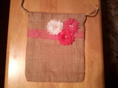 Burlap dollar dance bag embellished with white and shades of pink shabby chiffon roses.