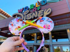 A daily-updated resource for news and information on the Disney resort around the world. Disney Springs, Ear Headbands, Cross Paintings, Purple Velvet, Mickey Ears, Ink Painting, Walt Disney World, Color Splash, Gifts