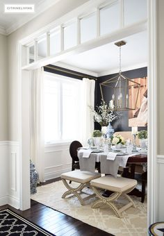 Dining room with elegant black wall color, Cracked Pepper Behr Paint, white wainscotting and transoms