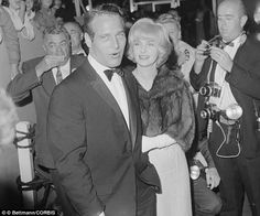 09 Apr 1962 --- Actor Paul Newman and wife, Joanne Woodward, as shown as they arrived at the Academy Awards presentations