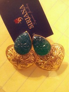 This is a beautifully carved green onex set in silver with 18ct gold plating.
