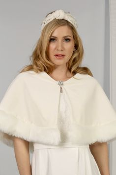 Wrap up warm for your winter wedding with this gorgeous ivory velvet cape, with pretty faux fur hem. Fastens with a sparkling brooch. Bridal Shrugs, Lace Shrug, Bridal Cape, Crystal Brooch, Fur Fashion, Vintage Looks, Faux Fur, Bell Sleeve Top, Ivory