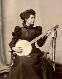 Proper lady with banjo. The banjo was, at one time, considered a lady's instrument.