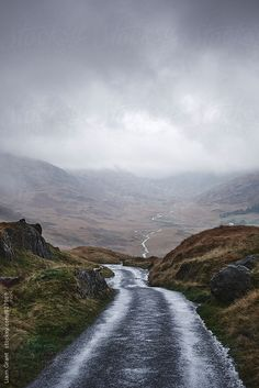 "unbleachedlinen: "" Rain clouds and road through the Wrynose Pass. Cumbria, UK. By liamgrant Available to license exclusively at Stocksy """