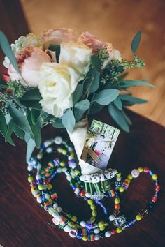 Wedding bouquet + photo and cancer awareness ribbon tied to bouquet {Brandy Angel Photography}