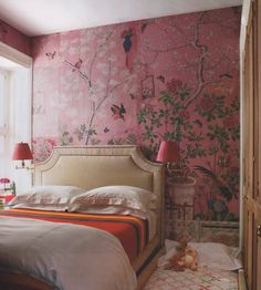 House Beautiful Photo by Ngoc Minh Ngo:  In this bedroom, interior designer David Kaihoi and his wife, Monique Simard, found a tattered pile of hand-painted, 18th century Chinese wallpaper at an auction. They found three scenes, placed them on the walls and filled in the gaps with bits and pieces.