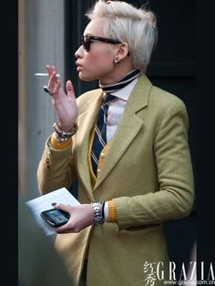 Esther Quek. Digging the coordinating neckerchief under the shirt, as well as the cardigan middle layer