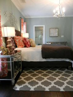 This eclectic master bedroom features a Surya flat weave wool rug from the Frontier Collection. The Moroccan inspired lattice pattern in gray is the perfect blend of casual and elegant worldly appeal. (FT-122)