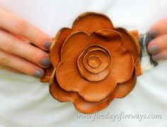Rose made from leather scraps,stitched and burned to make the petals curl.